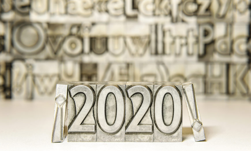 Metal type saying 2020! with blurry metal type in the background