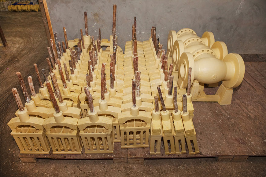Lost wax patterns in an investment casting foundry awaiting next processing steps