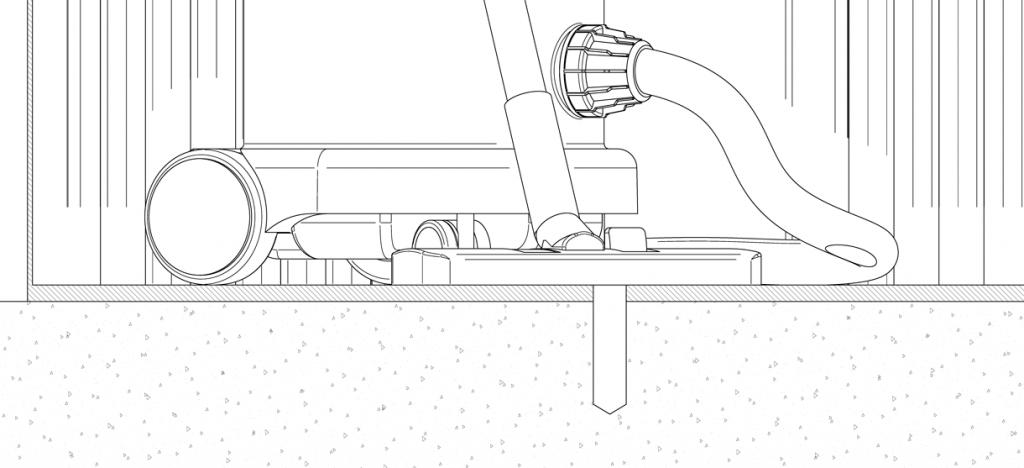 Vacuum clearing holes of debris