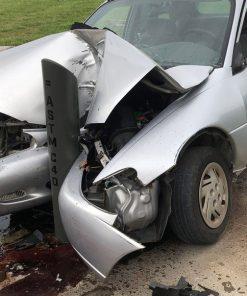 Car ramming into crash-rated bollard