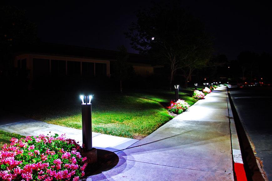 Illuminated bollards along path