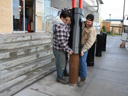 R-1007-04 steel pipe security bollard installation into concrete