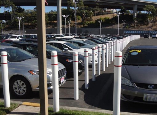 White R-7101 plastic bollard covers at parking lot
