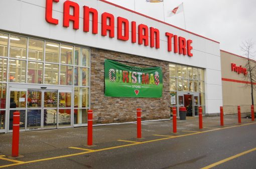 Red R-7109 plastic bollard covers in front of Canadian Tire store