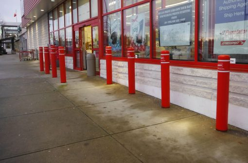 Red R-7109 plastic bollard covers at building entrance