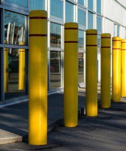 Row of R-7110 plastic bollard covers protect glass windows