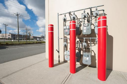 Red R-7120 plastic bollard covers protect utility box
