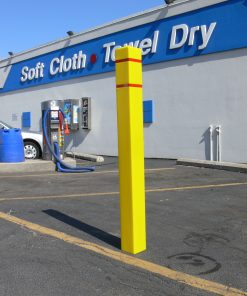 R-7140 plastic bollard cover in parking lot of car wash