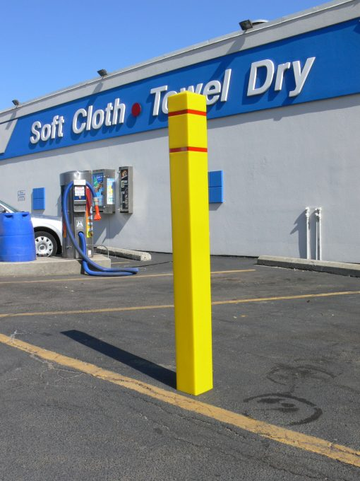 R-7150 plastic bollard cover in front of car wash business