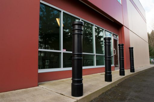 Row of R-7171 decorative plastic bollard covers protect building windows