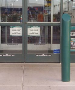 Green R-7175 decorative plastic bollard cover protects storefront