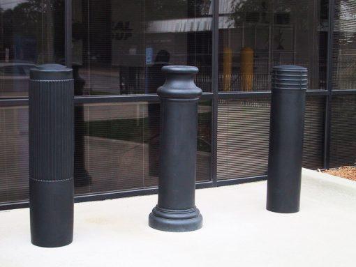 Row of R-7176 decorative plastic bollard covers