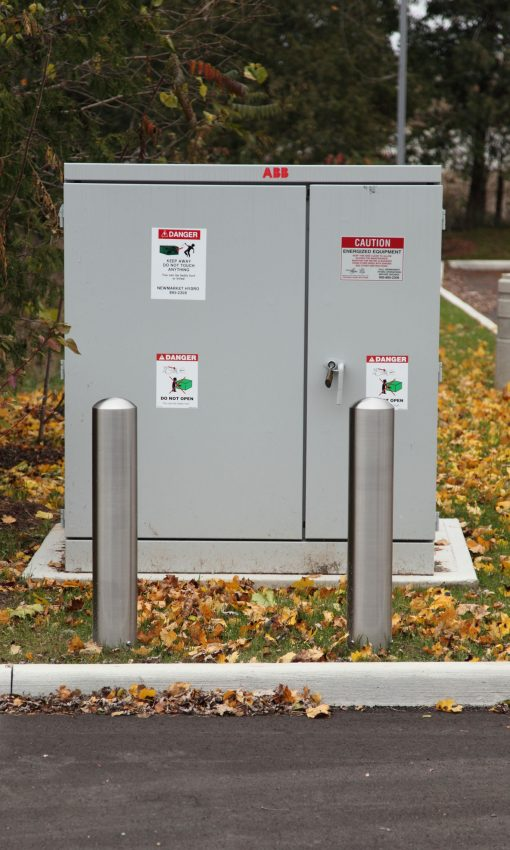 R-7301-EX stainless steel bollard in front of utility box