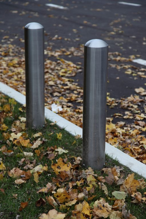 R-7301 stainless steel bollard covers on ground covered with leaves