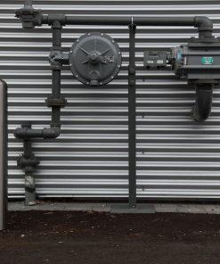 R-7301 stainless steel bollard protecting utility meter on wall