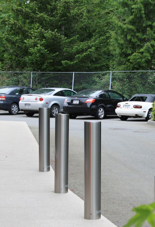 R-7303-EX stainless steel bollard covers with cars in the background