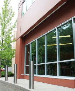 R-7303 stainless steel bollard covers in front of building windows
