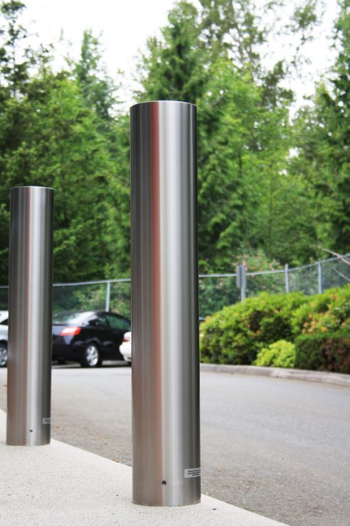R-7303 stainless steel bollard covers in parking lot