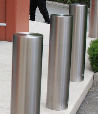 R-7311 stainless steel bollard cover along street curb