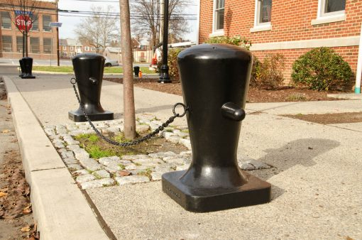 R-7510 decorative bollards with chains along street curb