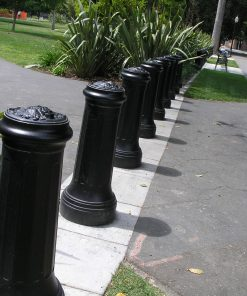 Line of R-7520 decorative bollards on top of concrete painted white