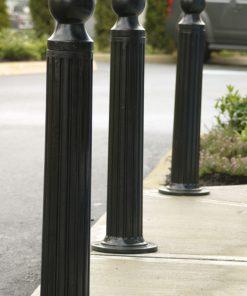 Three R-7530-AL decorative bollards outdoors