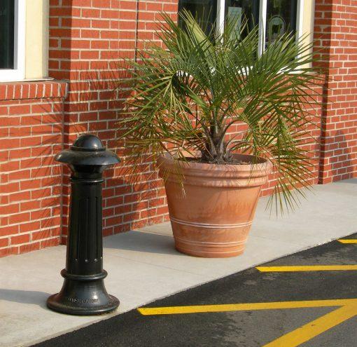 R-7538 decorative bollard stand protects brick building