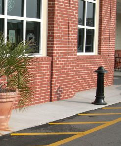 R-7538 decorative bollard stands in front of brick building