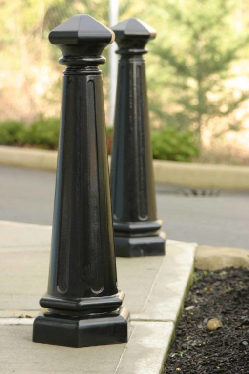 Two R-7542 decorative bollards outdoors