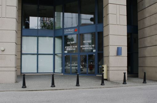 Line o R-7542 decorative bollards in front of office building