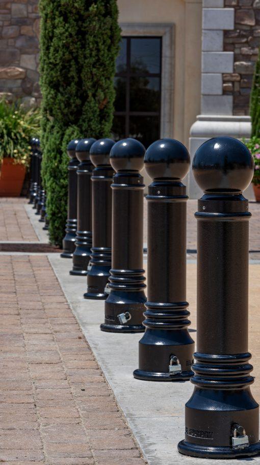 Line of Three R-7551 decorative bollards in concrete