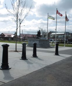 R-7563 decorative bollards in concrete with flags nearby