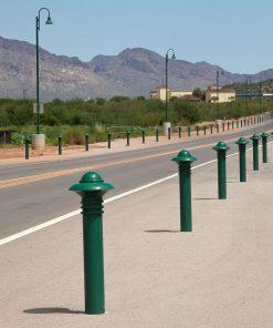 Rows of green R-7572 decorative bollards along highway