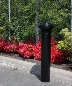 R-7573 decorative bollard in cement near red flowers