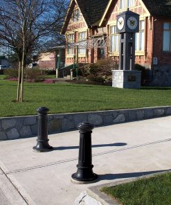 Two R-7581 decorative bollards guard driveway entrance