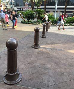R-7582 decorative bollards on a busy sidewalk