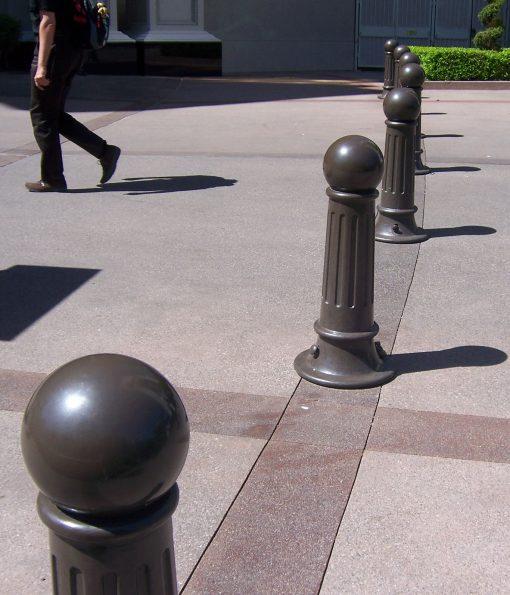 Row of R-7582 decorative bollards on pedestrian walkway