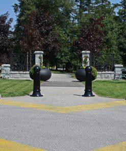 R-7582 decorative bollards on outdoor path near entranceway
