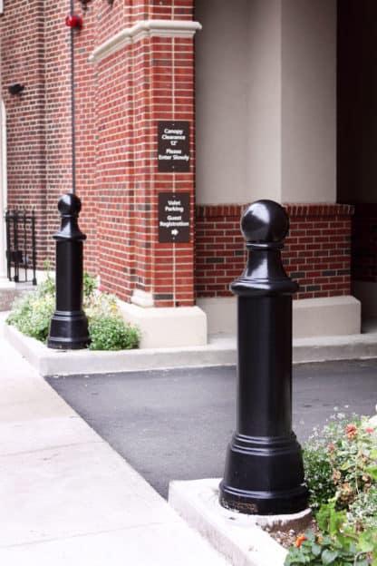R-7595 decorative bollard guarding entranceway