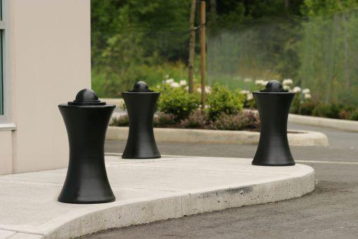 Three R-7611 decorative bollard on street corner