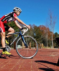 Cyclist biking past R-7611 decorative bollard
