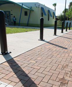 Black R-7642 bolt down bollards on pathway