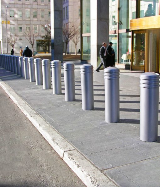 Row of silver R-7736 decorative bollards in front of building