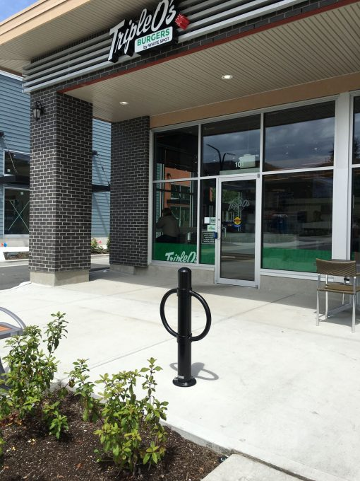 R-7906 post and ring bike bollard in front of restaurant