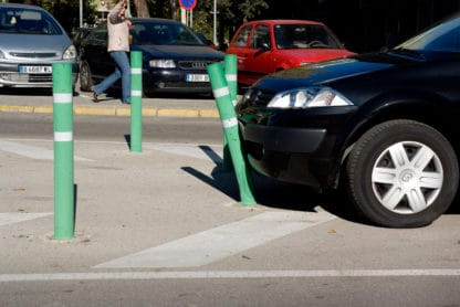 Green R-8302 flexible fixed bollard in front of car