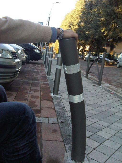 Person bending R-8303-FL flexible bollard