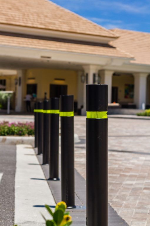 R-8303 flexible fixed bollards with yellow reflective strips