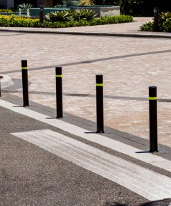 Line of R-8303 flexible fixed bollards by road