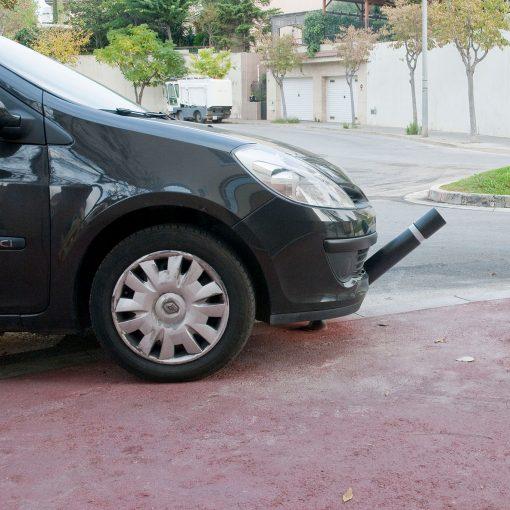 R-8303 flexible fixed bollard in front of car