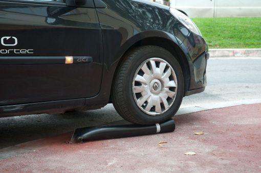 R-8303 flexible fixed bollard under car wheel
